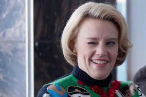 Carol Vanstone from Office Christmas Party winking, wearing an ugly Christmas sweater