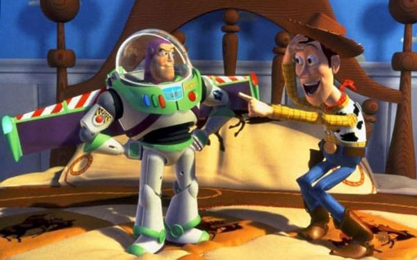 Buzz Lightyear and Sheriff Woody from Toy Story, Woody pointing excitedly off-screen